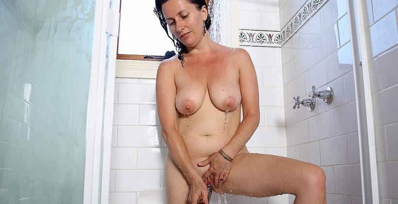 Busty MILF Toys Her Pussy In Shower