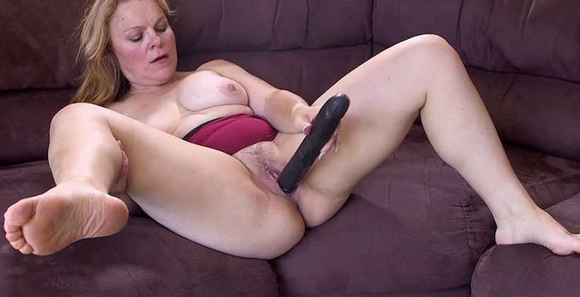Boxer Mom Inserts Big Black Dildo