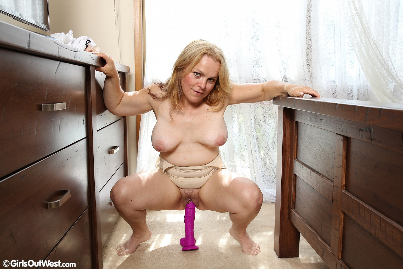 Busty lady toys cunt