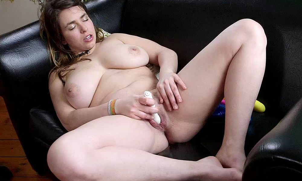 Huge Titted Gal Orgasms On The Sofa