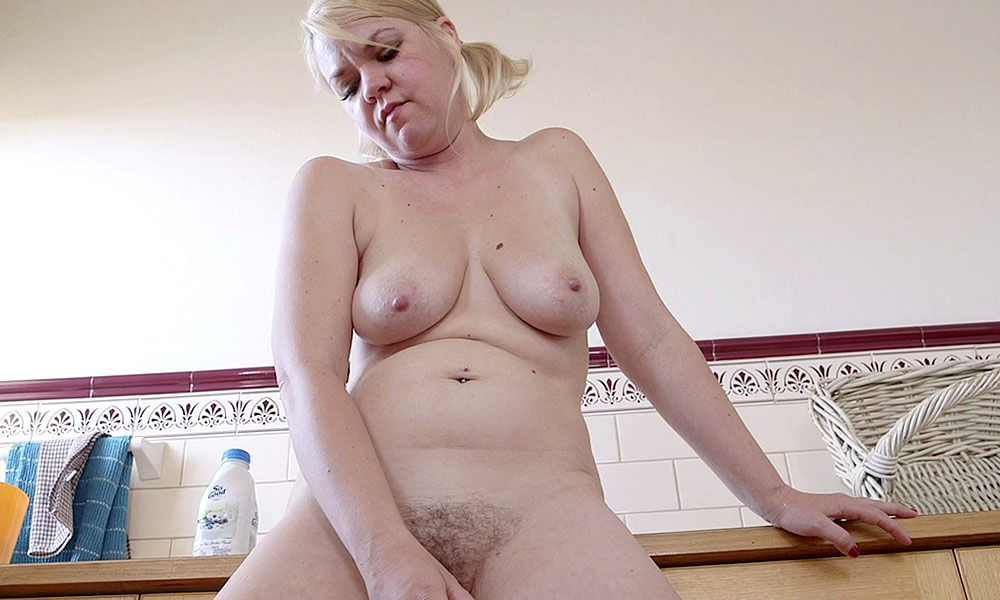Busty Housewife Prepares Milkshake