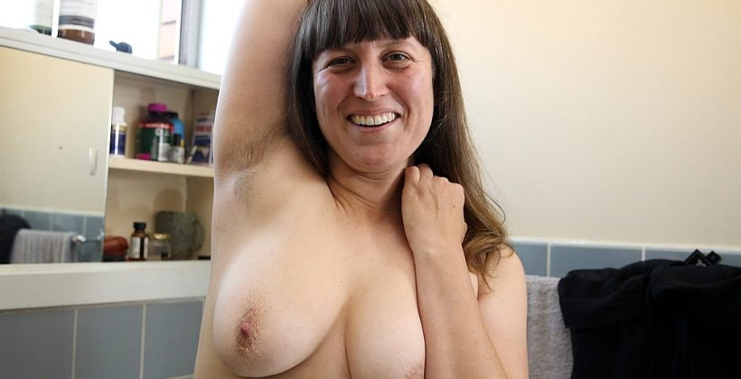 Hairy MILF Takes Off Her Clothes In The Bathroom
